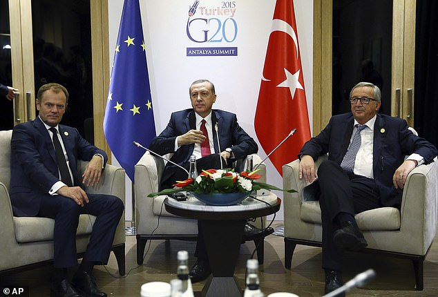 It was pointed out that in previous meetings in Turkey when both EU representatives were male, both were offered seats. Pictured: Turkey's President Recep Tayyip Erdogan, center, sits together as he holds a meeting with then EU Commission President Jean-Claude Juncker, right and then EU Council President Donald Tusk, left, Monday, November 16, 2015 (file photo)