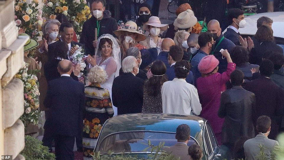 Here comes the bride! Crowds of extras and crew could be seen gathering to film the scenes