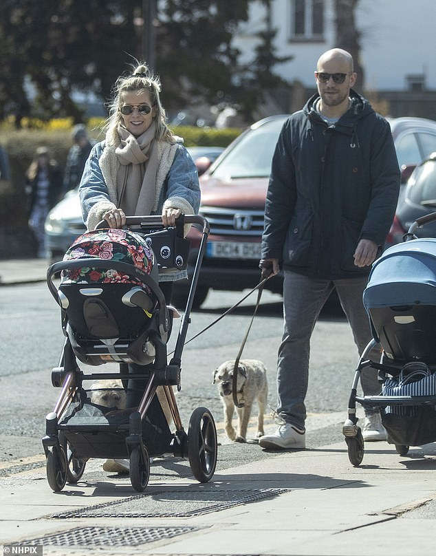 Family fun: Kate Lawler headed out on a lockdown walk in a denim jacket and cashmere scarf with her daughter Noa and husband-to-be Martin on Thursday