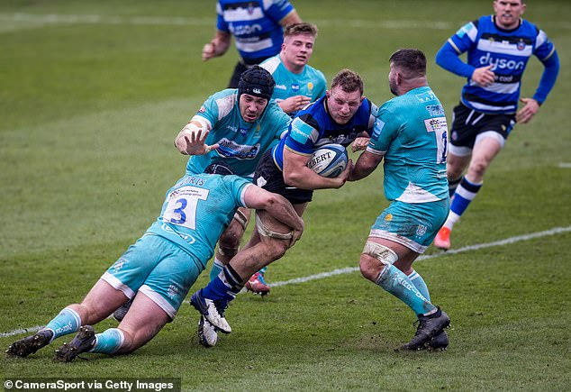 Sam Underhill (with ball) is back in action for Bath having missed the Six Nations through injury