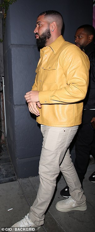 Taking it easy: The Grammy-winning artist paired his top with a pair of beige jeans and white sneakers