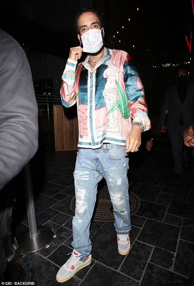 Staying safe: At one point, French Montana was seen putting on a white facial covering to keep himself protected while arriving at the event