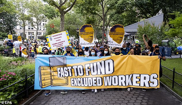 A protest last July calling for help for excluded workers impacted by the pandemic