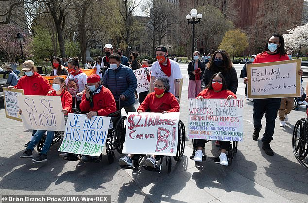 New York will offer $15,600 one-time payments to undocumented workers who lost their jobs during the pandemic. Pictured excluded essential workers at Washington Square Park in NYC Wednesday after the funds were approved