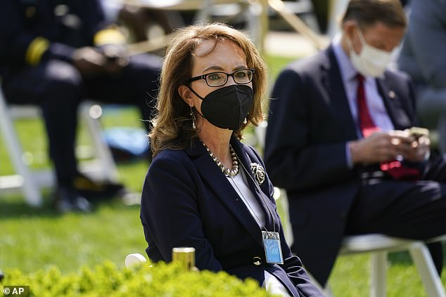 Gun control advocate Gabby Giffords - the congresswoman shot by a constituent at an event in Tucson, Ariz., in 2011 - was in the Rose Garden for the announcement