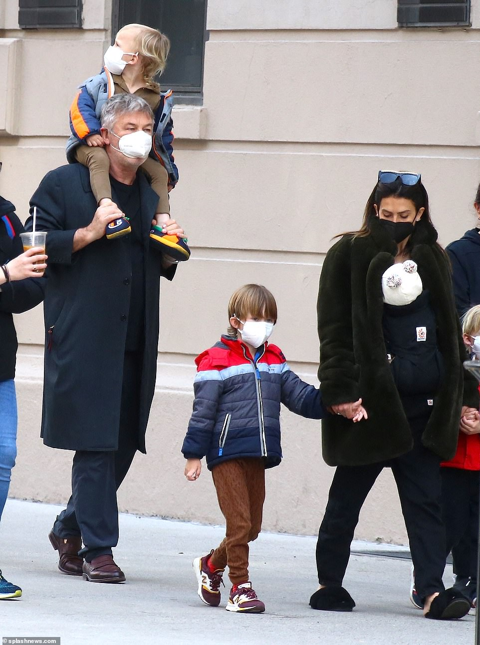 Safety precautions: The family were pictured wearing masks as they took safety measures against the spread of COVID-19 seriously, and Rafael, five, was seen holding his mum's hand