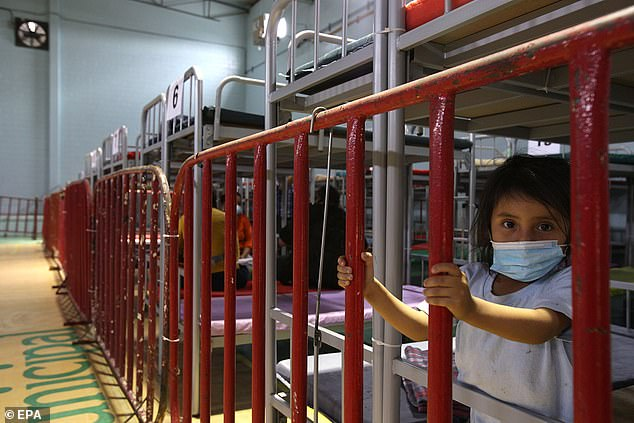 The image above from Tuesday shows a little girl at a new shelter for undocumented migrants trying to enter the United States. The shelter is located in Ciudad Juarez, Mexico.