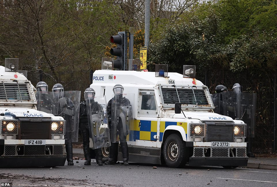 PSNI officers with riot shields on the Springfield road, during further unrest in Belfast.Police in Belfast faced a barrage of petrol bombs and rocks on Thursday, an AFP journalist said, as violence once again flared in Northern Ireland despite pleas for calm