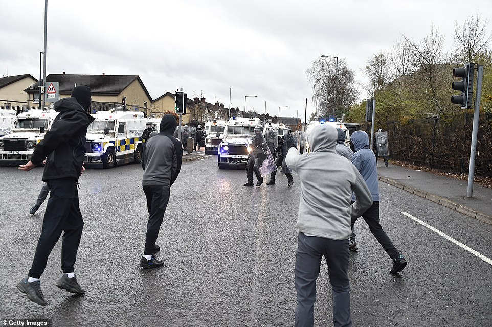 Nationalists attack Police on Springfield Road just up from Peace Wall interface gates which divide the nationalist and loyalist communities on April 8, in Belfast, Northern Ireland. Trouble has flared for a second night running in the Springfield Road area of Belfast. US President Joe Biden joined UK prime minister Boris Johnson and the Irish prime minister Micheal Martin in a call for calm