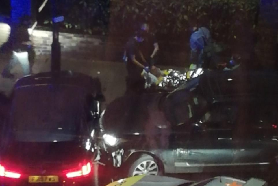 A man was seen being stretchered into an ambulance after the crash in west London on Wednesday night