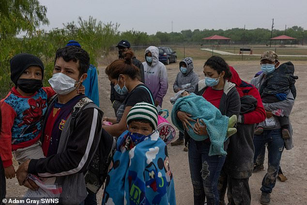 Asylum seeking migrants board a Border Patrol bus after crossing the Rio Grande from Mexico into the United States