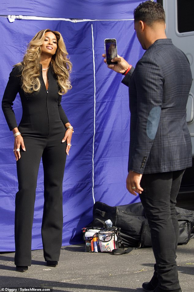 Looking fab:Russell Wilson snapped a picture of his wife Ciara as the duo emerged for a glamorous outing in Los Angeles this week
