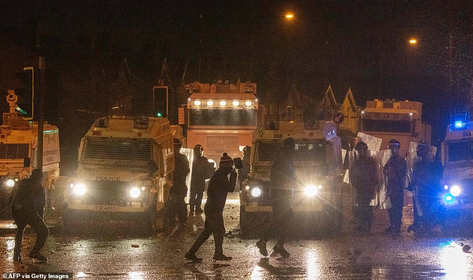 Police officers are attacked by nationalist youths in the Springfield Road area of Belfast on April 8, 2021 as disorder continued in the Northern Ireland capital following days of mainly loyalist violence
