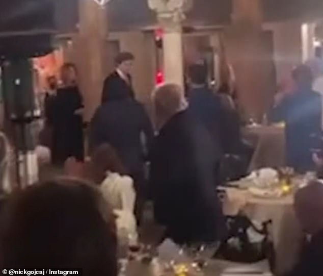 April 2: Melania (far left) wore a black off-the-shoulder dress for one of her recent appearances at Mar-a-Lago, when she, Barron (center) and Trump walked past diners at the resort
