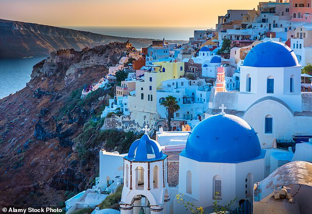 A review at the end of June could mean quarantine and testing requirements are slashed for a number of popular locations, including Greece which has seen a recent rise in case numbers. Pictured: The town of Oia on Santorini