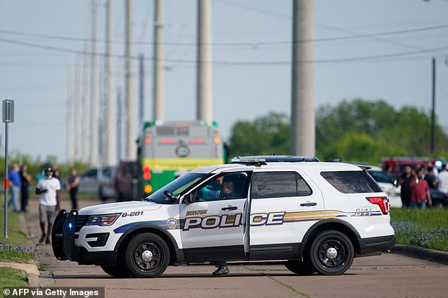 A Bryan police officer blocks road access near the scene of a mass shooting at an industrial park in Bryan in Bryan, Texas