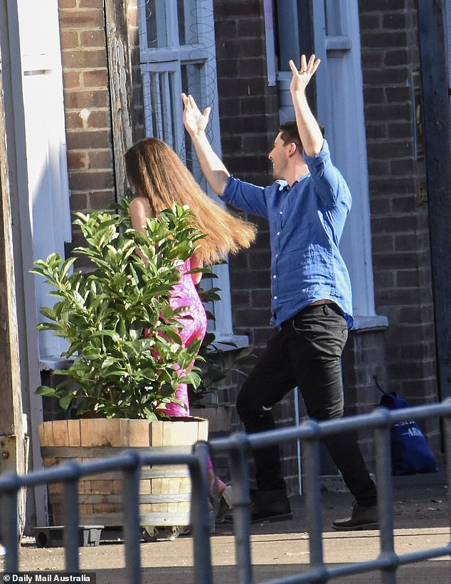 Caring: Her 'husband' Patrick, 27, was seen motioning towards his bride before they entered the warehouse together