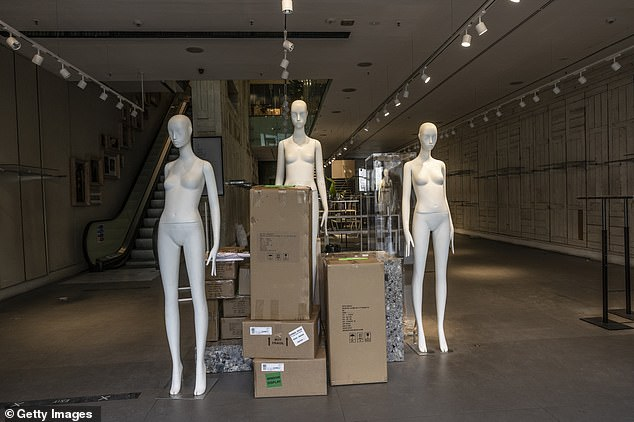Mannequins in an empty store on Oxford Street in London's West End yesterday as non-essential shops prepare to reopen