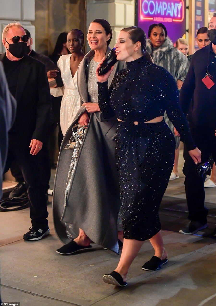 The big man: After the event, Ashley was seen with some of the other models as the walked down the sidewalk with Kors, who wore all black and was masked up