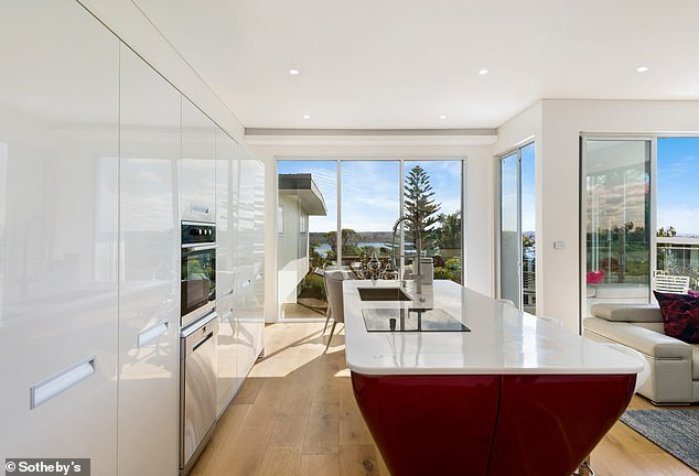 Real estate sale shares did well on Friday with Domain Group adding 0.7 per cent to $4.71 and its larger rival the REA Group, the company behind realestate.com.au, added 0.8 per cent to $154.79. Pictured is a Vaucluse home in Sydney's east
