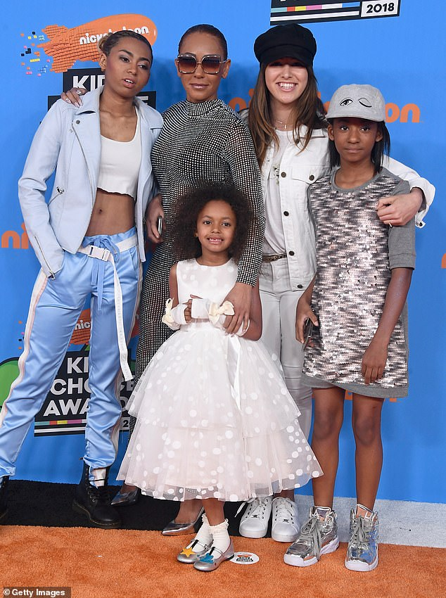Family: In addition to her and Belafonte's daughter Madison, Mel B is mother to daughters Phoenix, 22, whose father is her first husband Jimmy Gulzar, and Angel, 14, whose father is Eddie Murphy (pictured with Stephen's daughterGiselle in 2018)