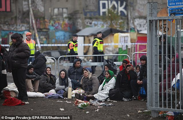 Migrants entering Sweden will be required to speak Swedish in order to become citizens under new laws the country is expected to introduce this summer. Pictured:Swedish Police Evict Migrants From an illegal camp in Malmo, Sweden, November 3, 2015