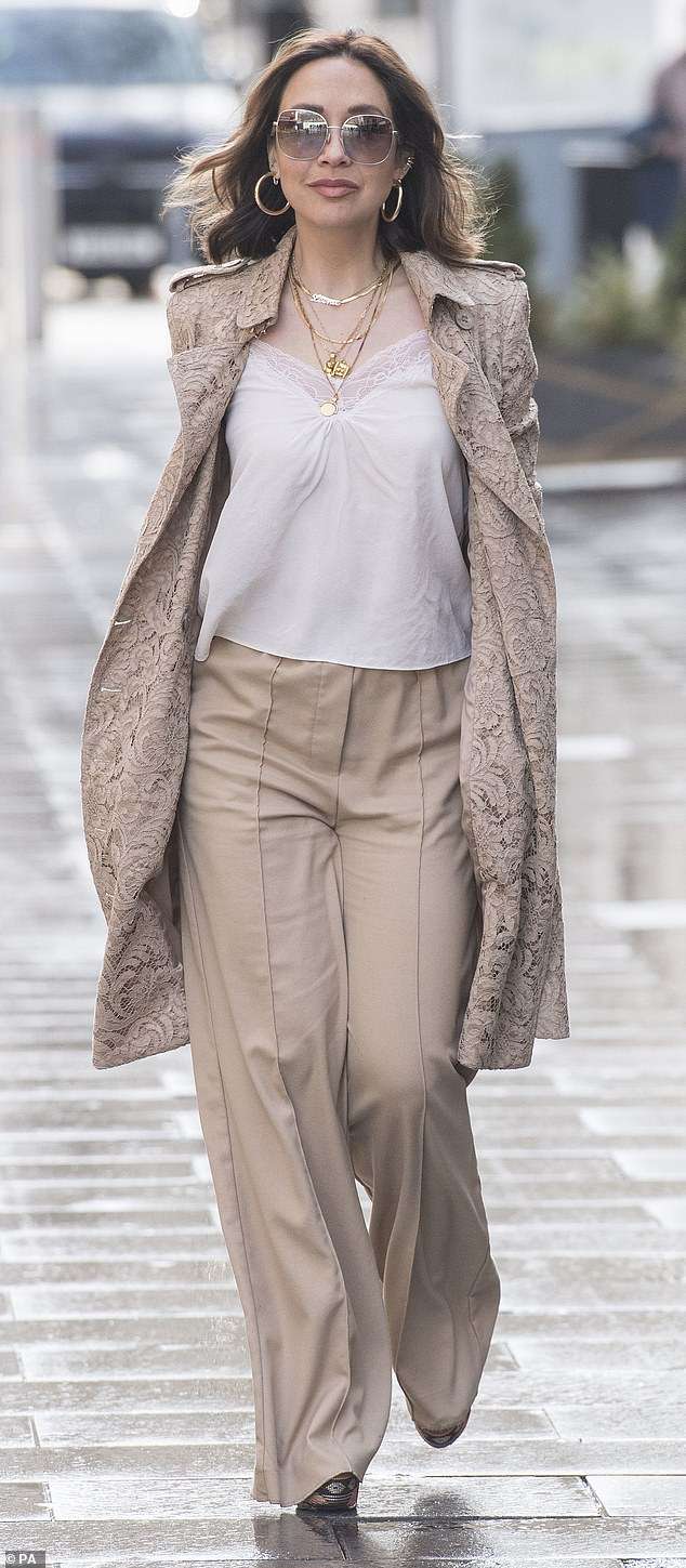 Stylish: Myleene Klass was showing off another fabulous ensemble in a lace trench coat and cream wide-legged trousers when she arrived at Smooth Radio on Friday