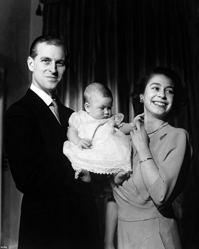 Queen Elizabeth II and The Duke of Edinburgh holding their first child, Prince Charles, barely six months old, in April 1949