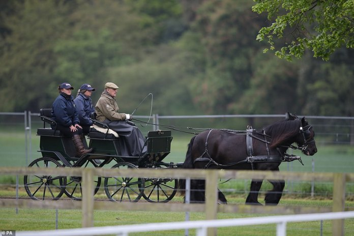 The Duke of Edinburgh, accompanied by two assistants, at the Royal Windsor Horse Show in Windsor, Berkshire on May 9, 2019