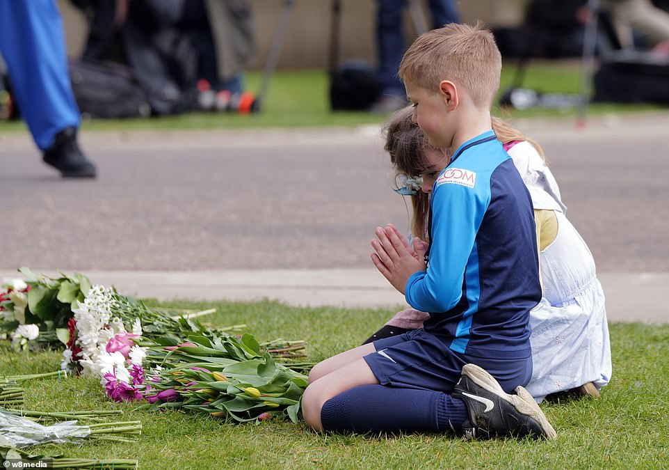 Windsor Castle saw children praying for the late Duke of Edinburgh today as crowds started to gather outside