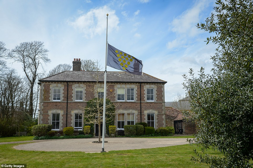 The Duchy of Cornwall flag flies at half mast at their headquarters in Poundbury on Friday afternoon as the nation mourned