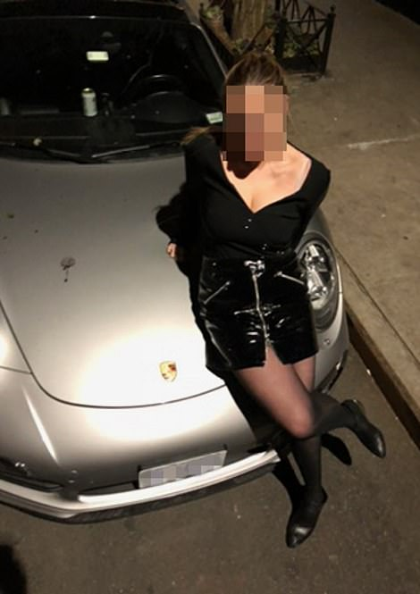 Among the photos on Hunter's laptop was this photo of a woman leaning on what's believed to be his silver Porsche