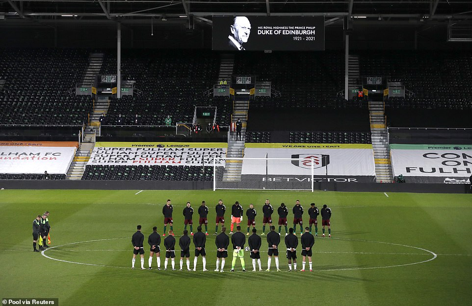 Players during a minute's silence at the Fulham v Wolverhampton Wanderers match after Prince Philip died