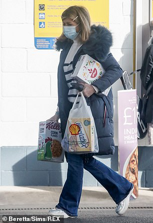 Loaded down: Kate carried one Cornflakes box under her arm and another in her hand