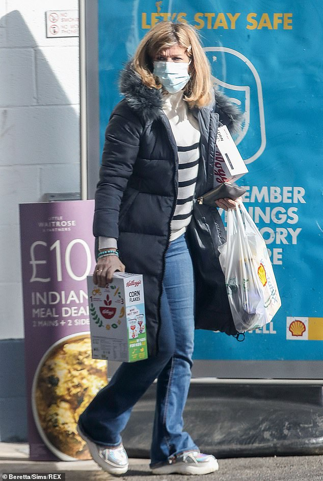 Sticking to the rules: Kate ensured to wear a blue face mask while inside the store