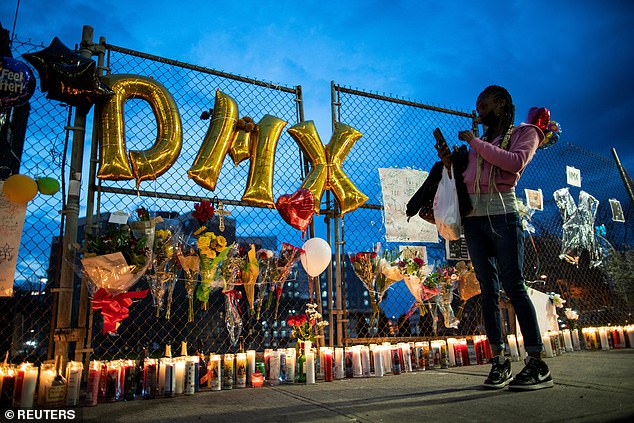 By nightfall, candles lined the fence to the hospital and people continued to gather
