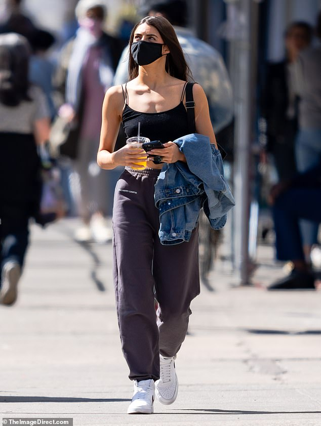 Kirkconnell flaunted her slender figure in a black cropped tank top with spaghetti straps, which showcased her toned tummy