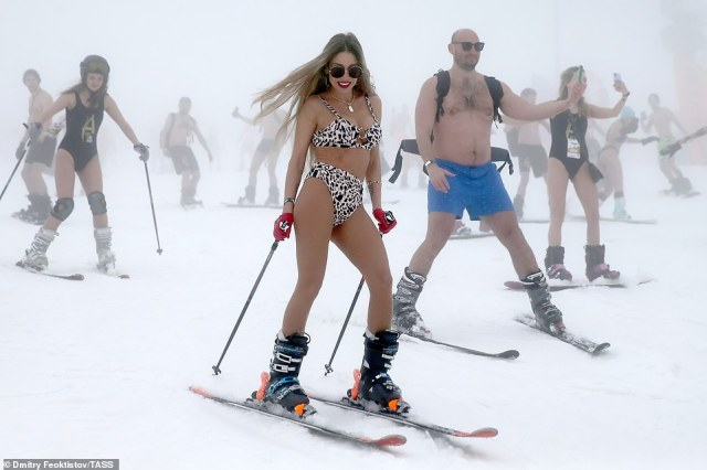Scantily clad skiers sport bikinis and shorts as they take to the slopes at theBoogelWoogel alpine festival in Sochi, Russia