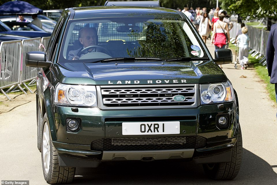 The Duke of Edinburgh's coffin will be transported in a ceremonial procession to his funeral on a Land Rover he helped to design. Pictured, the Duke driving his Landrover Freelander four wheel drive in 2011