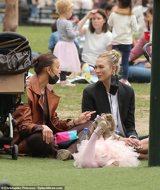 Maternity: Models Karlie Kloss and Irina Shayk looked happy as they enjoyed a sunny afternoon in Washington Square Park with their young children on Friday