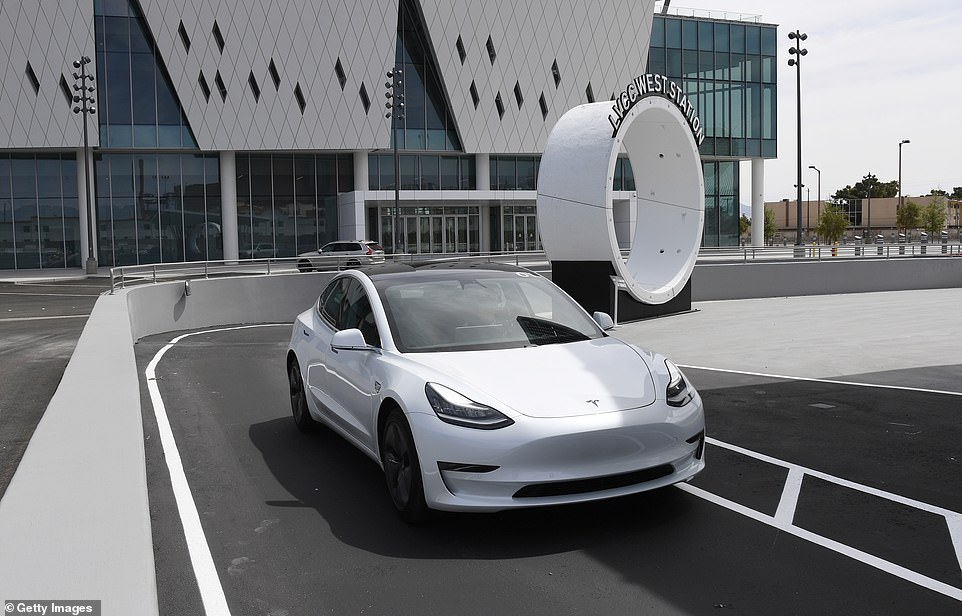 A Tesla car drives through the West Station near the Las Vegas Convention Center West Hall expansion during a media preview of the Las Vegas Convention Center Loop on Friday