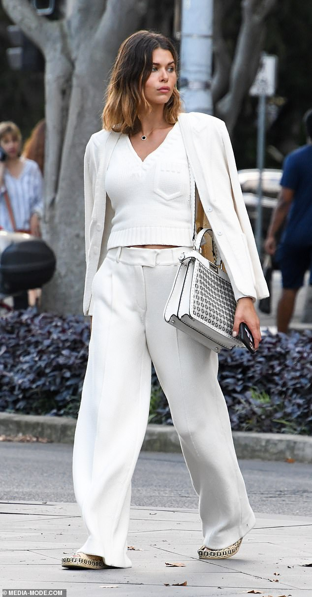 Very good in white!  Model Kiwi was dressed to impress in a white V-neck knit sweater which she paired with flowing white dress pants and a matching blazer jacket.