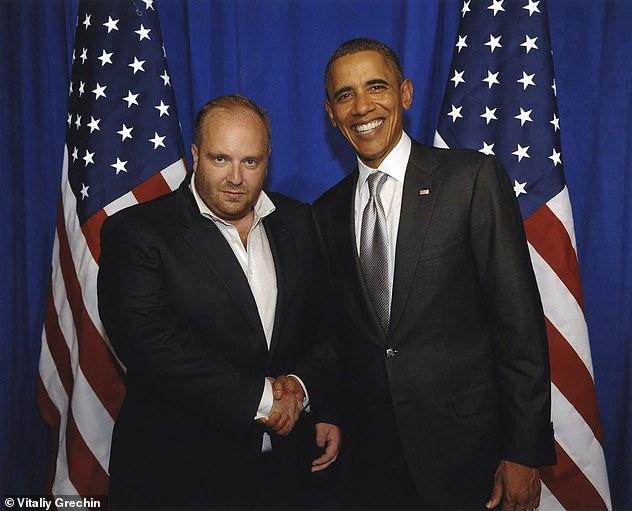 Vitaliy Grechin poses with Barak Obama in 2011