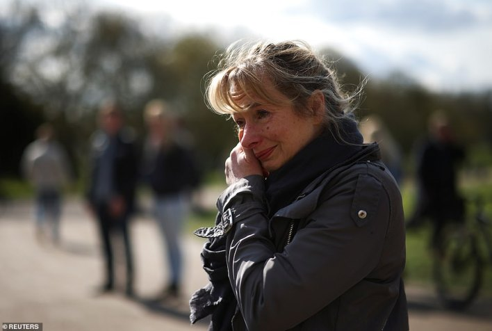 A woman outside of Windsor Castle this morning is seen shedding a tear as she pays her respects to Prince Philip, the husband of Queen Elizabeth II