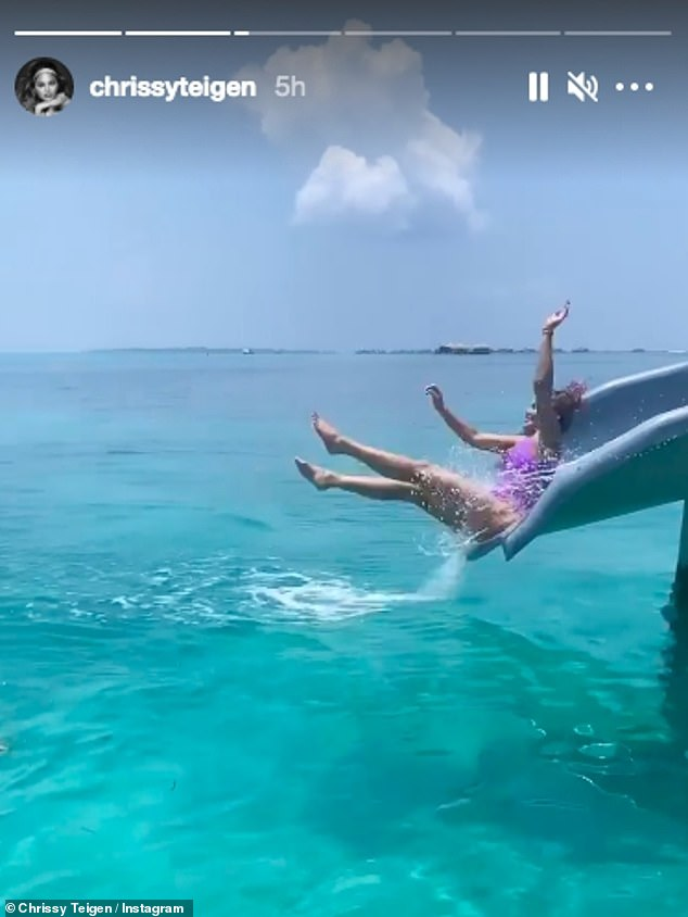 Having fun: The beauty shared another glimpse of her day soaking up the sun as she brought down a water slide and crashed into the sea in a video