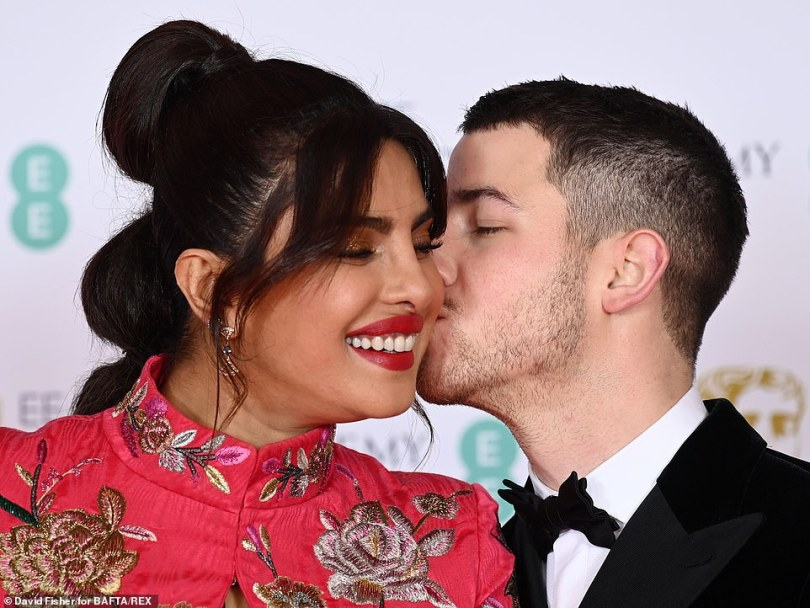 Cute: The couple put on a cosy display as they headed into the awards ceremony together