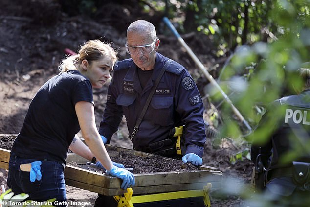 Investigators examine compost for human remains behind Fraser's house in 2018