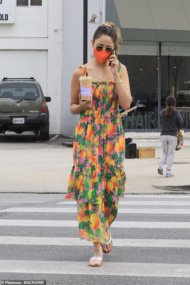 Citrus style!  Godzilla vs. Kong action star Eiza González stood out in a 70s-style orange-print gathered dress during her iced coffee run on Sunday morning.