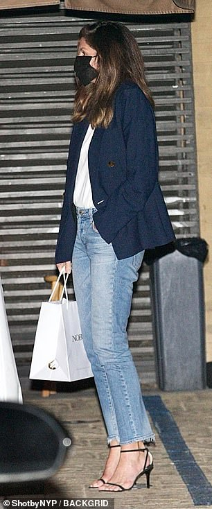 Not too fancy: the model also wore a pair of slightly distressed blue jeans and black heels