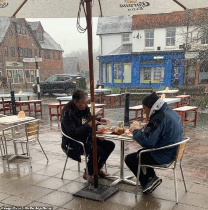 Two hardy customers tucking into breakfast this morning at the Yangaz Bistro Grill in Cranleigh, Surrey